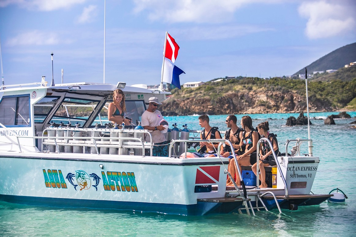 dive boat with family scuba diving